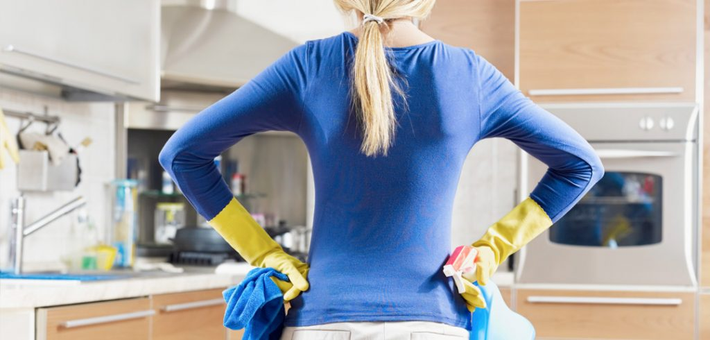 Women with Rubber Gloves Cleaning Kitchen