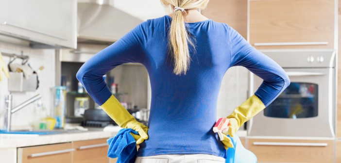 Women Cleaning Kitchen With Gloves On