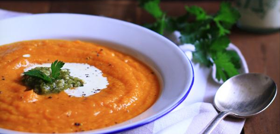 Bowl of Tasty Tomato and Pumpkin Soup with Spoon