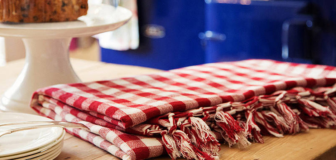 Red Gingham Tea Towel on Wooden Table