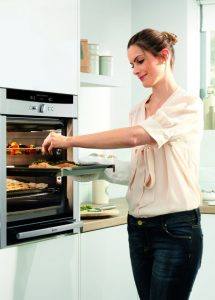 Woman Using Neff Slide and Hide Oven