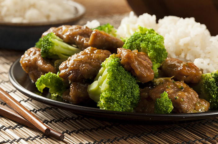Beef Broccoli and Rice on Black Plate