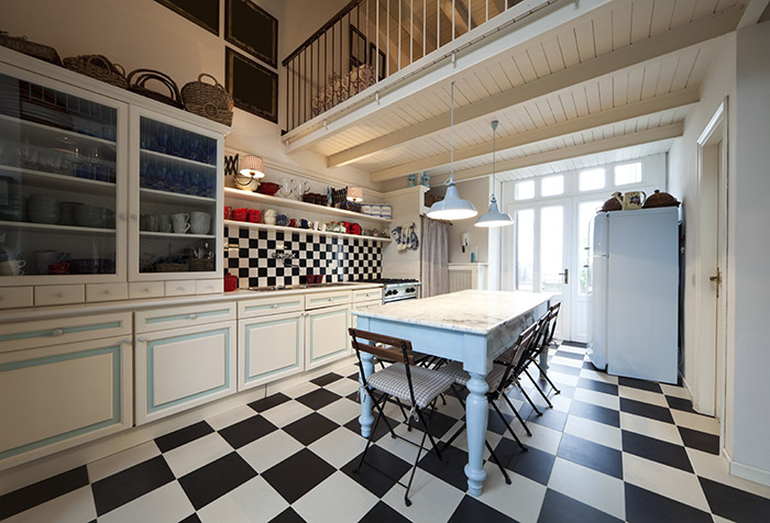Large Kitchen With Black and White Floor Tiles