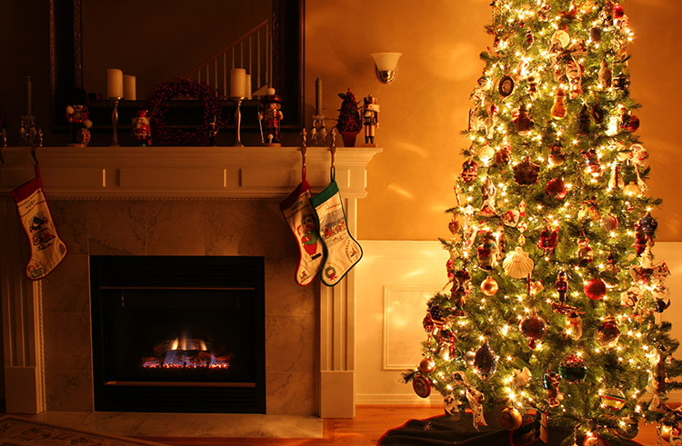 Traditional Christmad Tree and Stocking Hung Over Fireplace