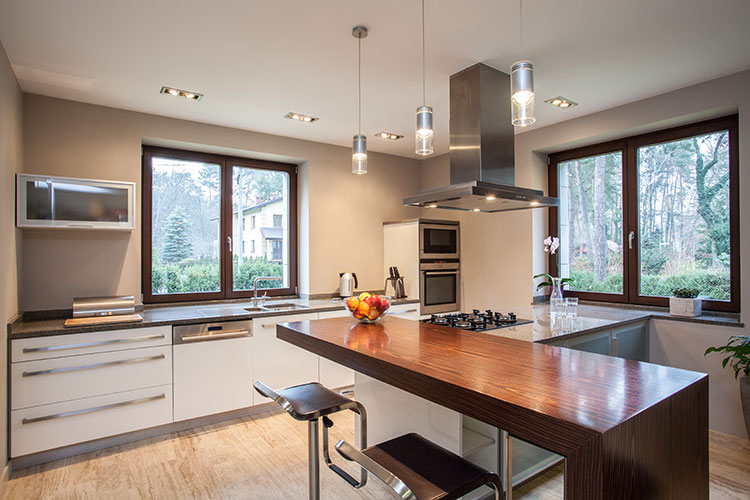 Modern Style Kitchen With Breakfast Bar And Seats