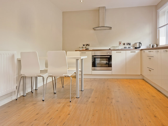 Spacious Cream Kitchen With Wooden Floor