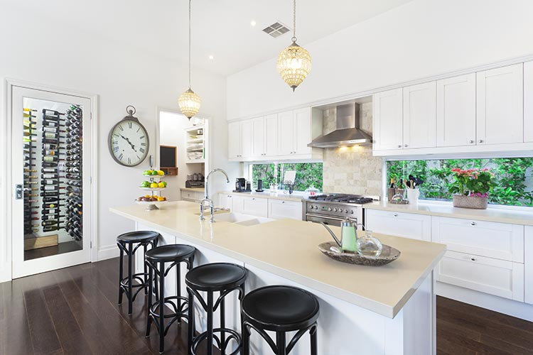 Intricate Pendant Lighting in Bright White Kitchen