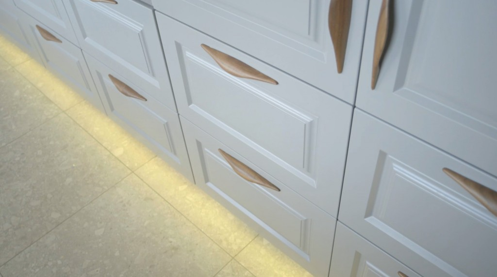 Cabinets With Walnut Handles And Under-Cabinet Ambient Lighting