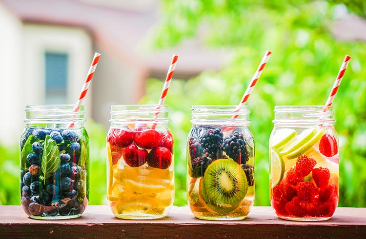 Line of Fresh Fruit Juices With Pretty Straws