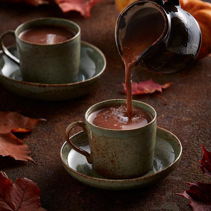 Pouring Pumpkin Spiced Hot Chocolate into Mug