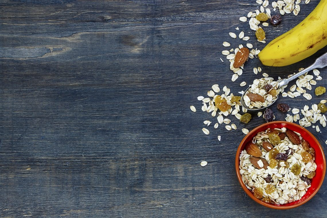 Breakfast Grains Scattered on Wooden Table