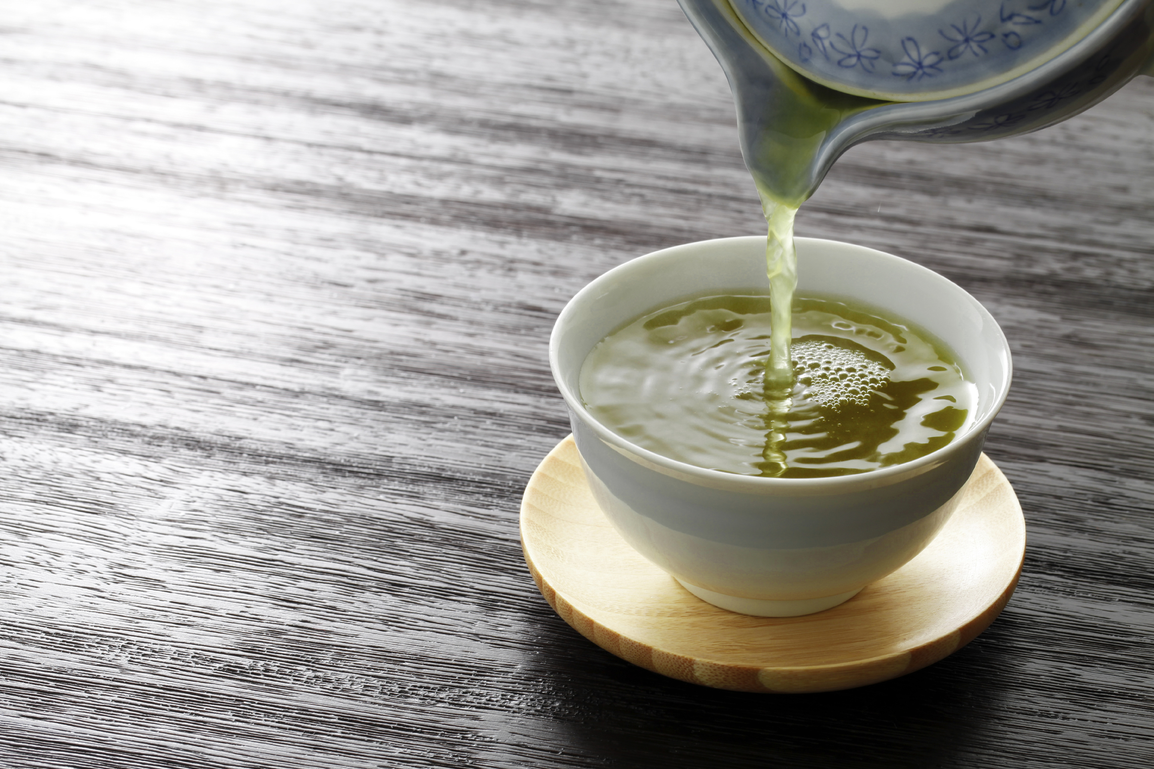 Kettle Pouring Green Tea