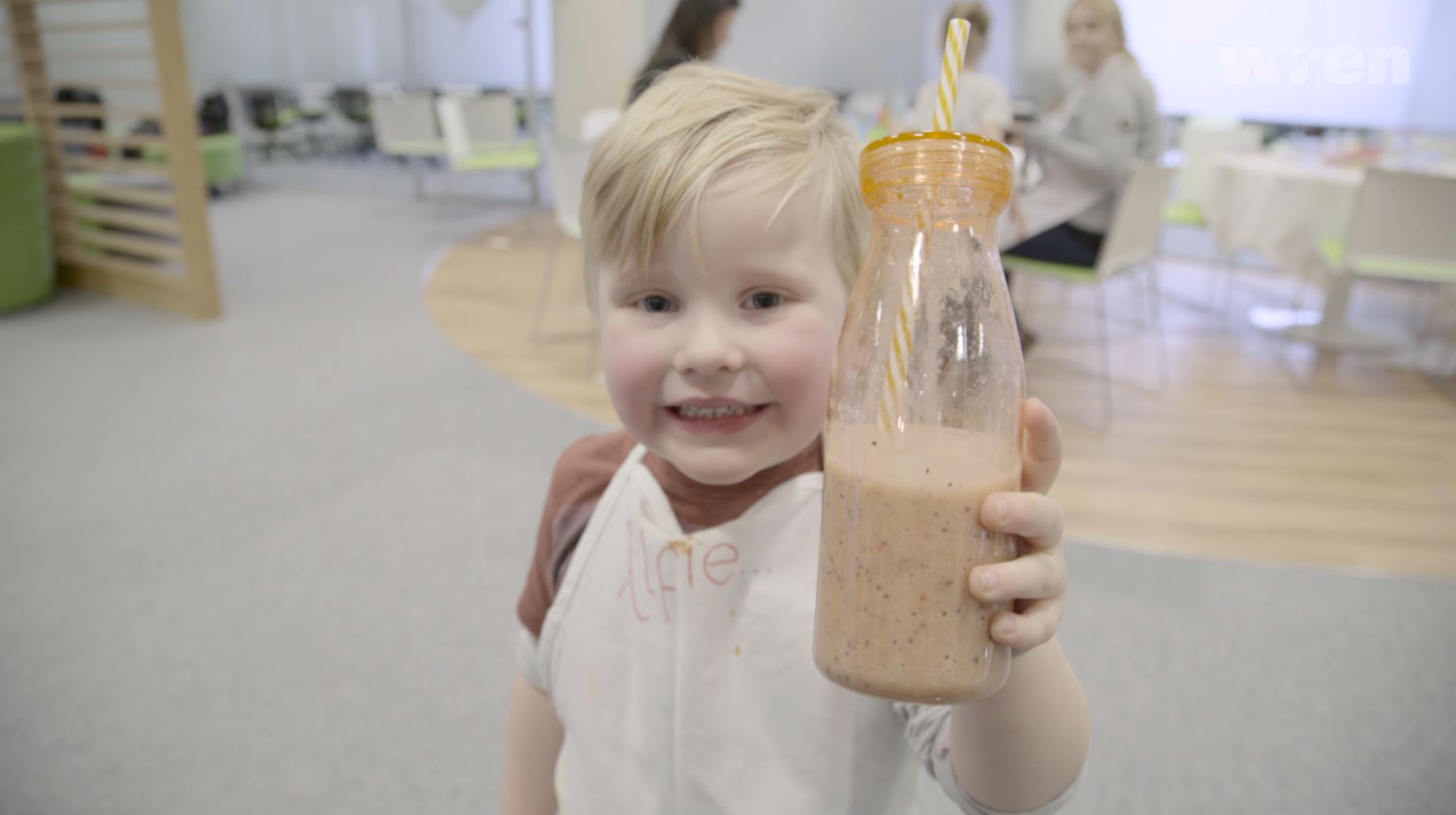 Little Boy Holding Fruit Smoothie