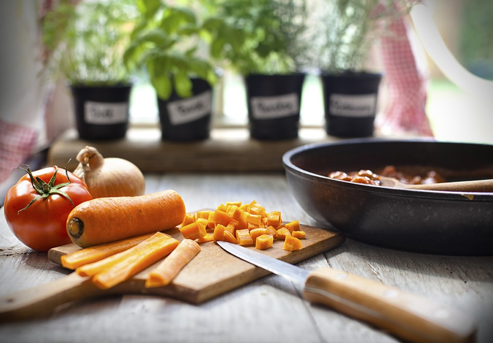 Cooking with Herb Pots on Windowsill