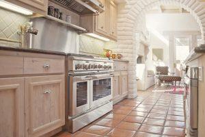 narrow-kitchen-cream-cabinets-terracotta-tile-floor