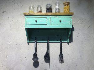 Mint Green Kitchen Shelf with Utensil Hooks on Grey Wall