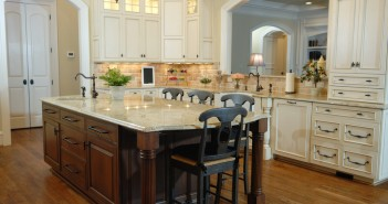 Mediterranean style kitchen with wood island