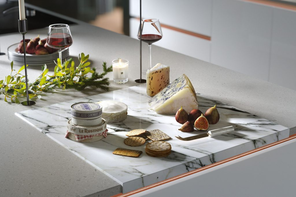 Wren Kitchens cheese and wine selection on a quartz veined worktop