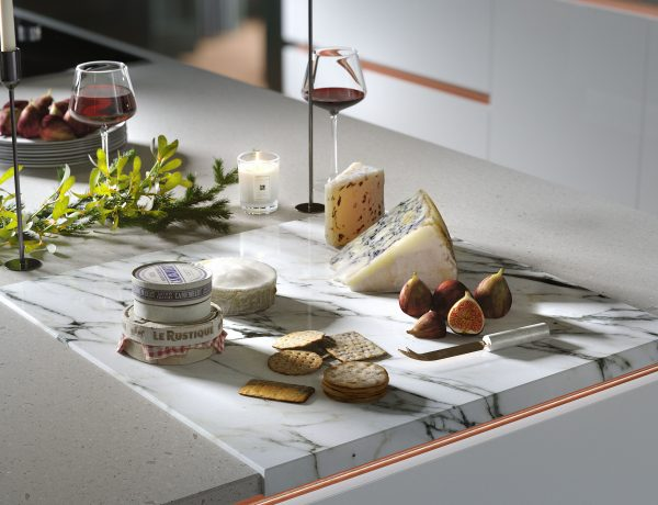 Wren Kitchens cheese and wine selection on a quartz worktop