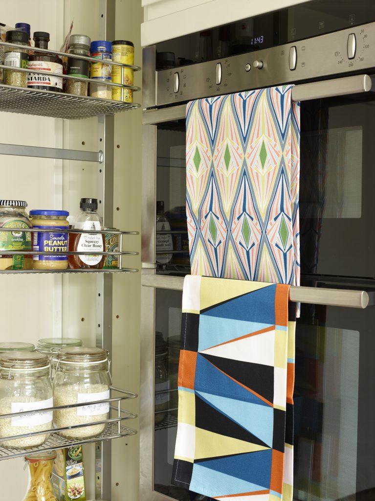 Handleless white gloss kitchen with a slimline larder