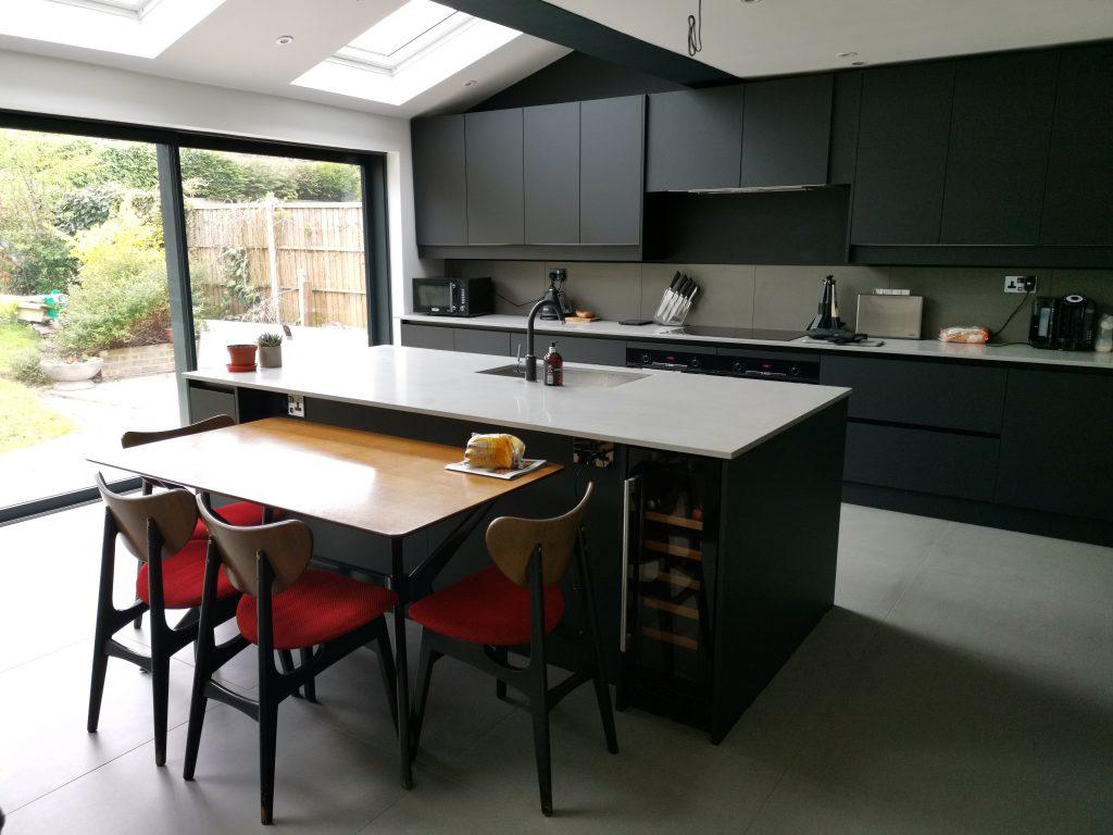 Black kitchen with white worktop
